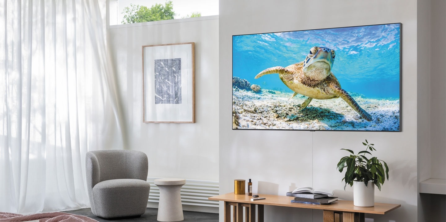 Samsung QLED TV wall mounted in living room